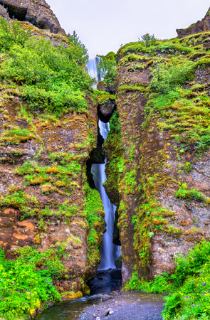 obscured: Gljufrafoss or Gljufrabui, a waterfall obscured by a rock - South Iceland