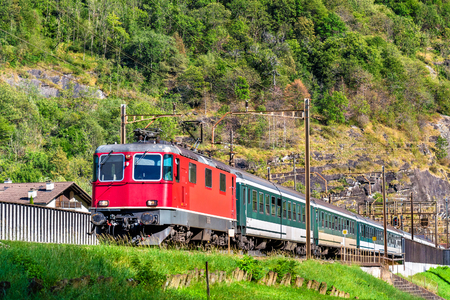 Passenger train is climbing up the Gotthard pass. The traffic will be diverted to the Gotthard Base Tunnel in December 2016. Stock Photo
