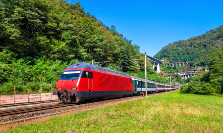 Passenger train is going down the Gotthard pass. The traffic will be diverted to the Gotthard Base Tunnel in December 2016.