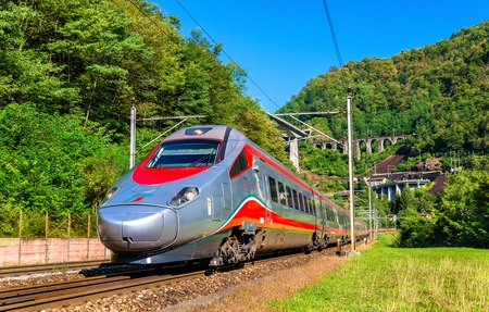 Giornico, Switzerland - September 25, 2016: Alstom ETR 610 tilting high-speed train on the Gotthard railway. The traffic will be diverted to the Gotthard Base Tunnel in December 2016. Editorial