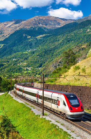 Anzonico, Switzerland - September 25, 2016: Swiss RABDe 500 tilting high-speed train on the Gotthard railway. The traffic will be diverted to the Gotthard Base Tunnel in December 2016.