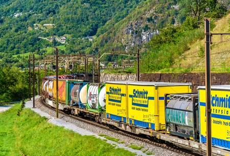 Chiggiogna, Switzerland - September 25, 2016: Freight train is climbing up the Gotthard pass. The traffic will be diverted to the Gotthard Base Tunnel in December 2016.