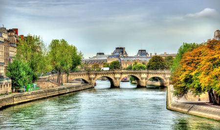 The Seine River and the Pont Neuf bridge in Paris - France Stock Photo