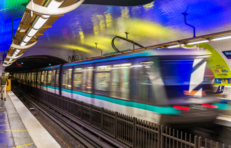france station: Paris, France - October 9, 2016: Metro train leaving Montparnasse - Bienvenue station. Paris Metro is one of biggest metro systems in the world Editorial