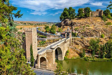 View of the Alcantara Bridge in Toledo, Spain Stock Photo