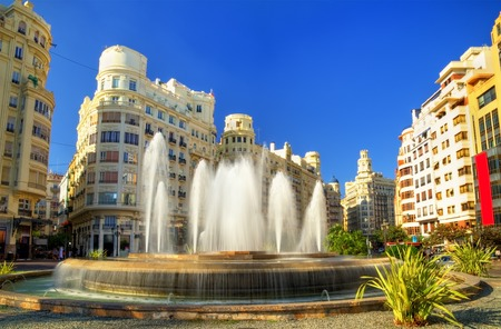 modernisme: Valencia, Spain - October 29, 2016: Fountain on the Plaza del Ayuntamiento or the Modernisme Plaza of the City Hall of Valencia Editorial