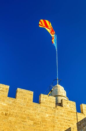 Flag of the Valencian Community on Serranos Gate in Valencia, Spain