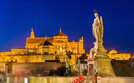 Statue of Archangel Raphael on the Roman Bridge in Cordoba - Spain, Andalusia