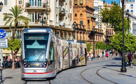Seville, Spain - November 1, 2016: MetroCentro tram on Avenida de la Constitucion. These trams are able to run without overhead wire 新聞圖片