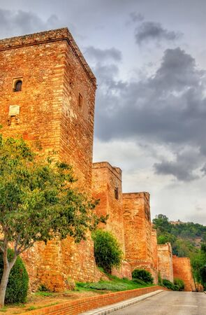 spanish architecture: Stone walls and towers of the Alcazaba Fortress in Malaga. Spain. Andalusia. Stock Photo