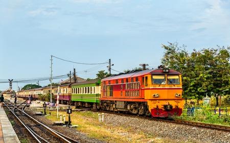 narrow gauge railroad: Passenger train for Bangkok departs from Ayutthaya station - Thailand