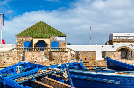 bastion: Blue fishing boats in the port of Essaouira, Morocco