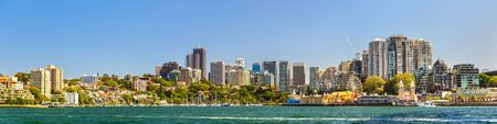 city park boat house: Panorama of North Sydney central business district with Lavender Bay and Luna Park Editorial