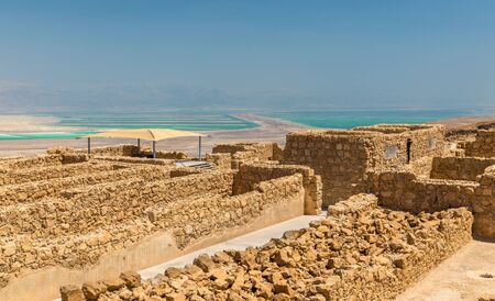 judean hills: Ruins of Masada fortress and Dead Sea
