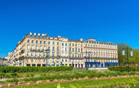 Buildings and garden on Quai Louis XVIII in the historic centre of Bordeaux, France Stock Photo