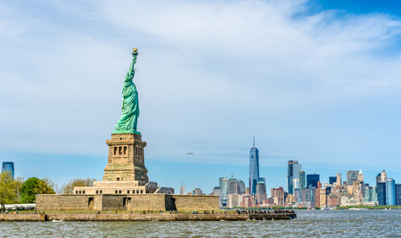 popular: The statue of Liberty and Manhattan, New York City