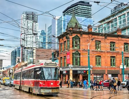 Old streetcar on a street of Toronto. The Toronto streetcar system is the largest and the busiest light-rail system in North America