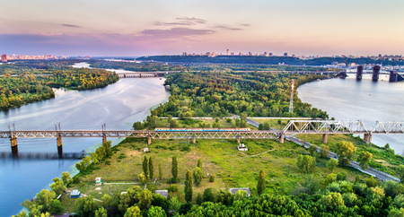 Kiev Urban Electric Train on the Petrovsky Railway Bridge in Ukraine