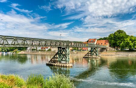 Eiserner Steg bridge across the Danube River in Regensburg, Germany