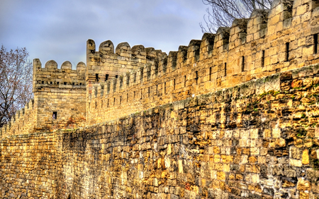 Ancient fortress wall in Baku old town, Azerbaijan Editorial