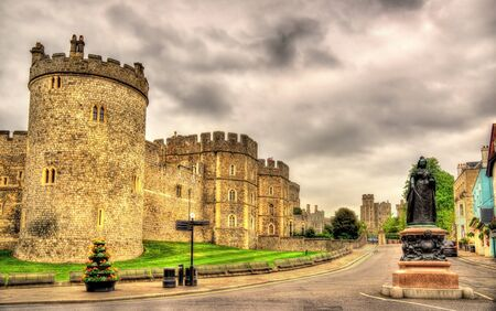 Statue of Queen Victoria and walls of Windsor Castle - England