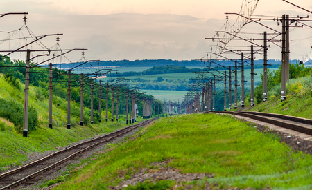Double-track electrified (3 kV DC) railway line in Ukraine Stock Photo