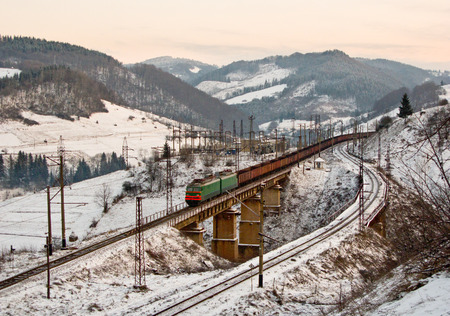 Freight train climbs the Beskyd pass in Carpathians