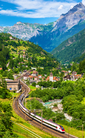 Express train at old the Gotthard railway. The traffic will be diverted to the Gotthard Base Tunnel in December 2016. Stock Photo