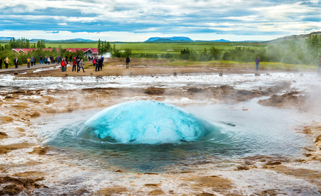 View of Strokkur geyser about to erupt - Iceland Stock Photo