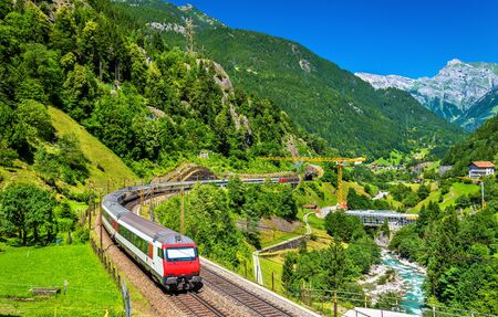 Intercity train at the Gotthard railway. The traffic will be diverted to the Gotthard Base Tunnel in December 2016. Stock Photo