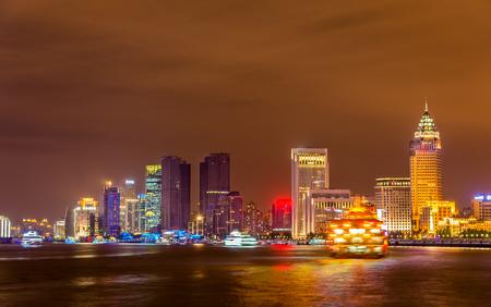 Shanghai skyline above the Huangpu River at night, China Stock Photo