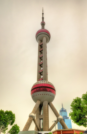 The Oriental Pearl Radio and TV Tower in Shanghai - China Stock Photo