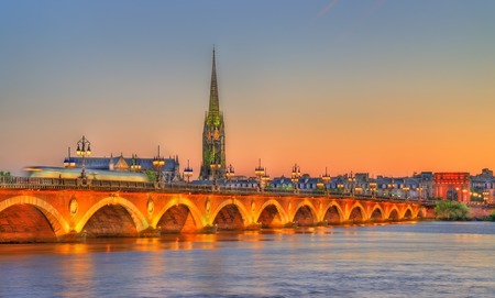 Pont de Pierre bridge and Saint Michel Basilica in Bordeaux - France, Gironde Stock Photo