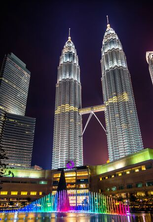 Kuala Lumpur, Malaysia - January 2, 2017: View of the Petronas Twin Towers and a fountain underneath. They are the tallest twin towers in the world. Editorial