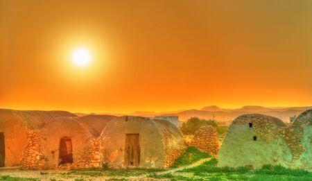Sunset above Ksar Ouled Boubaker in Tunisia Stock Photo