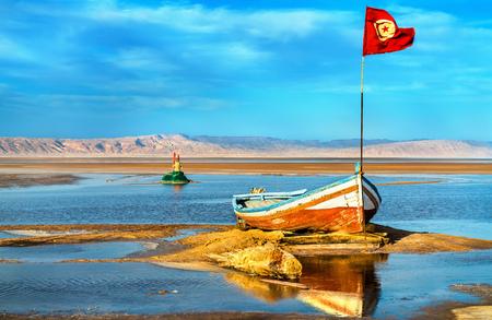 Boat on Chott el Djerid, an endorheic salt lake in Tunisia