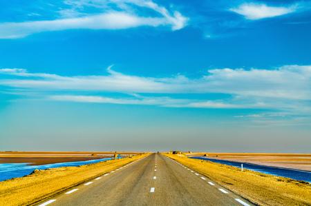 Highway through Chott el Djerid, an endorheic salt lake in Tunisia