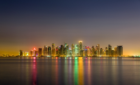 Skyline of Doha at night. The capital of Qatar 写真素材