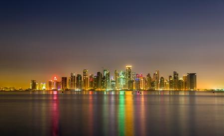 Skyline of Doha at night. The capital of Qatar Stock Photo