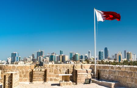 Bahrain Flag with skyline of Manama at Bahrain Fort