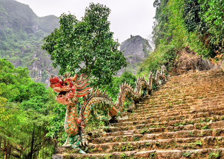 Dragon statue as banister for the stairway of Hang Mua viewpoint near Ninh Binh, Vietnam