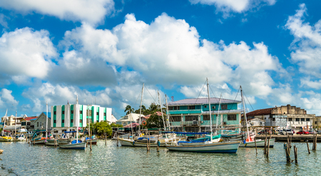 Houses and yachts at Haulover Creek in Belize City 写真素材