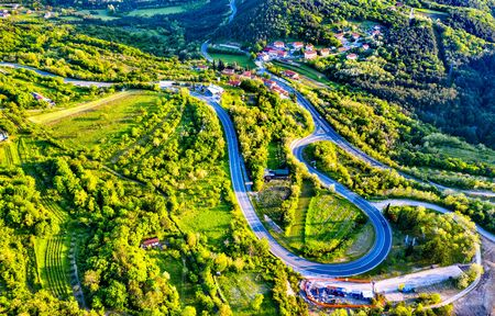Aerial view of a winding road in Slovenia