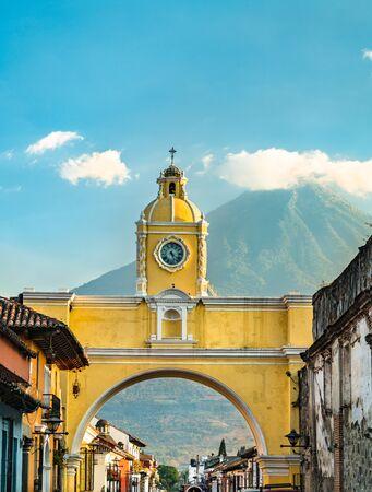 The Santa Catalina Arch and Agua Voclano in Antigua Guatemala, Guatemala Stock Photo
