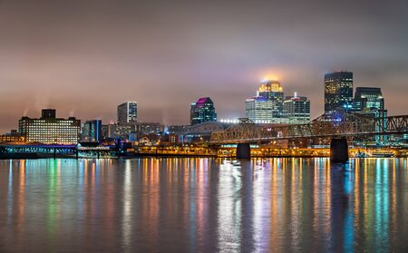 Night skyline of Louisville, Kentucky over the Ohio river in the United States