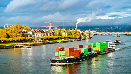 Container ship on the Rhine River in Mainz, Germany Stock Photo