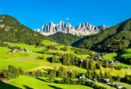 Panorama of the Dolomites with a chruch at Santa Maddalena in Italy