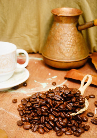 cezve: coffe beans on the table with cezve. Stock Photo