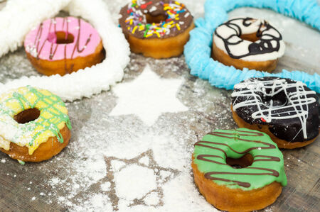 bright donuts on wooden background. photo