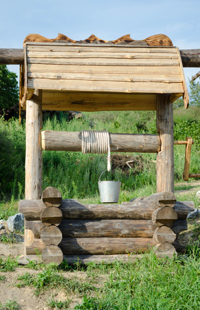 draw well: Old draw well with metal bucket.